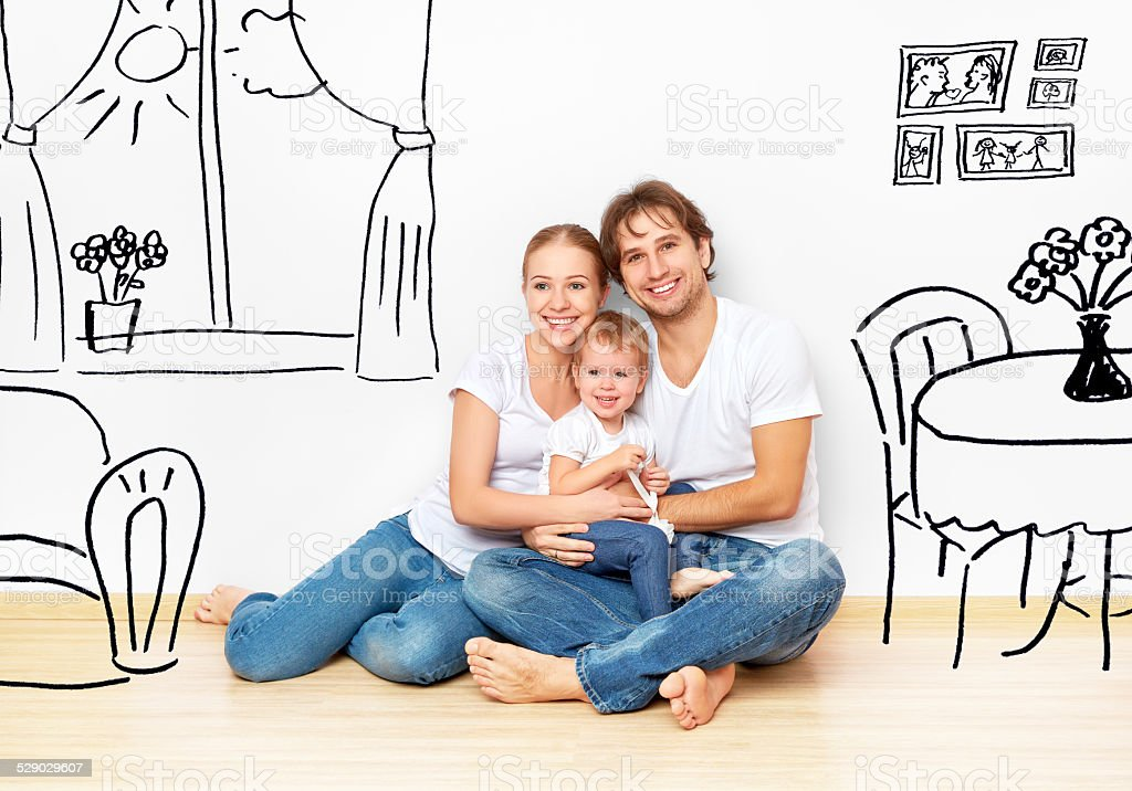 happy young family in  new apartment dream and plan interior stock photo