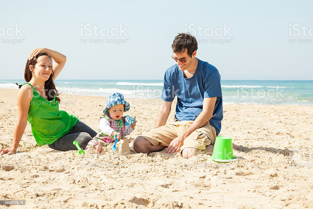 Happy young family on beach stock photo