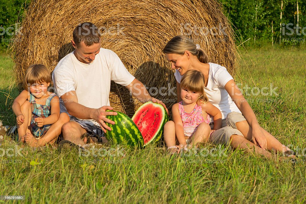 Happy young family on vacation royalty-free stock photo