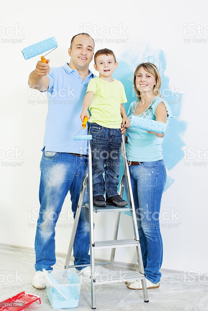 Happy Young Family Painting the wall royalty-free stock photo