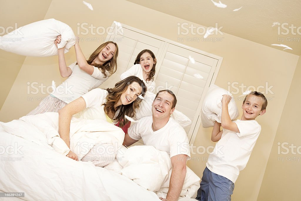 Happy Young Family Pillow Fight stock photo