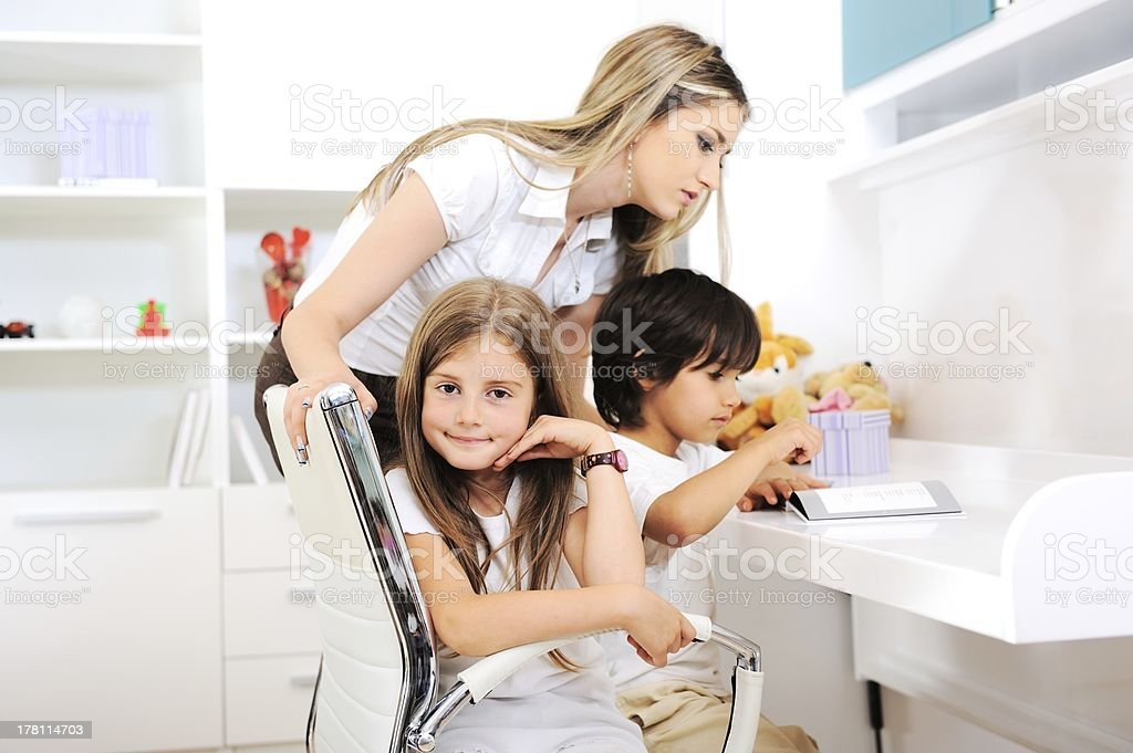 Happy young family together at home stock photo