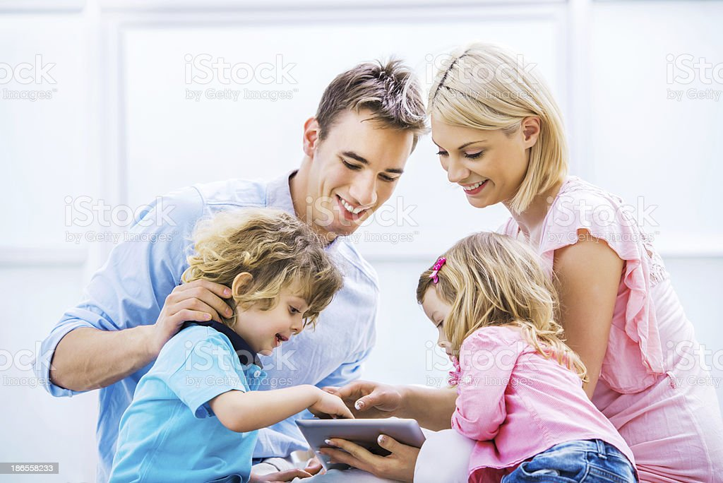 Happy young family using touchpad. royalty-free stock photo