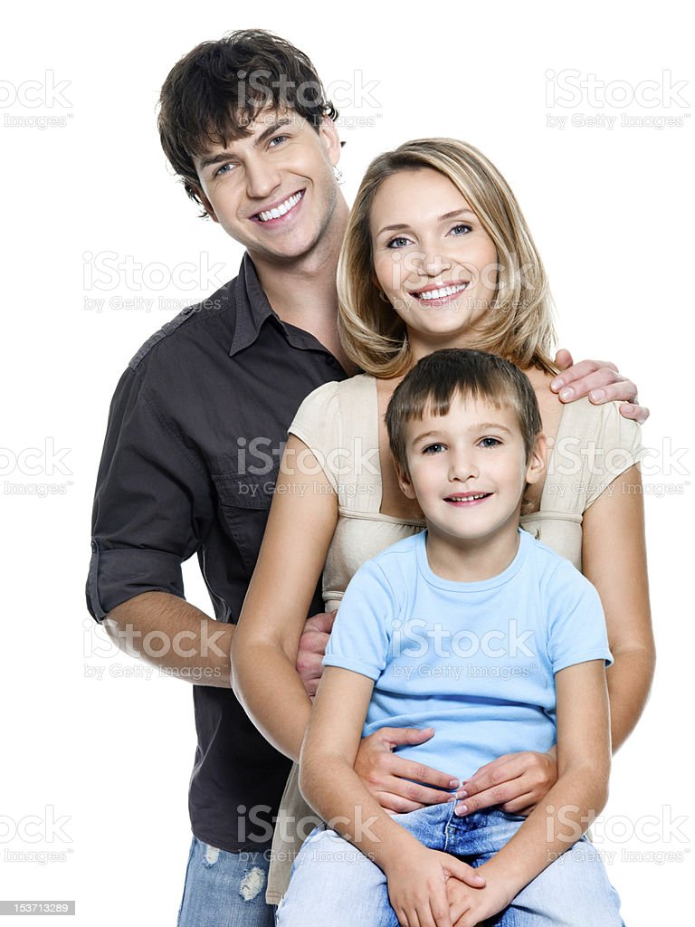 Happy young family with pretty child stock photo