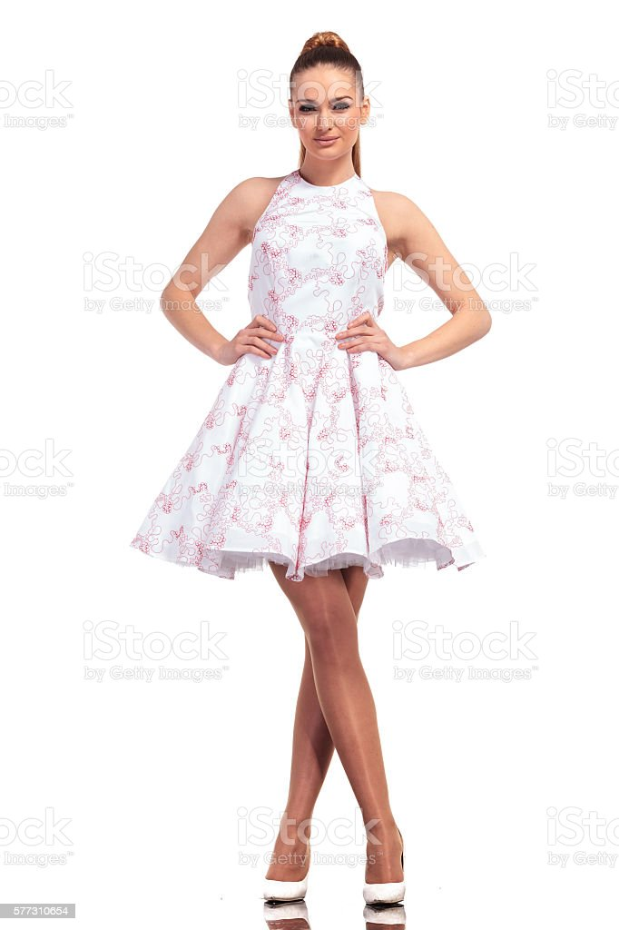 Happy young fashion woman smiling stock photo