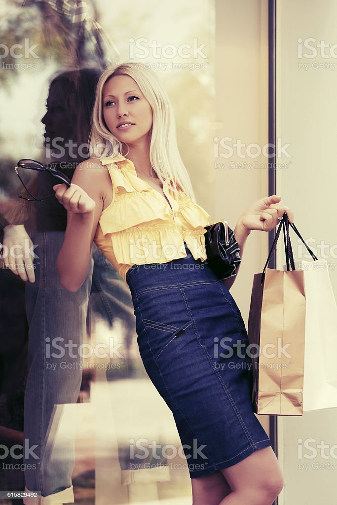 Happy young fashion woman with shopping bags stock photo