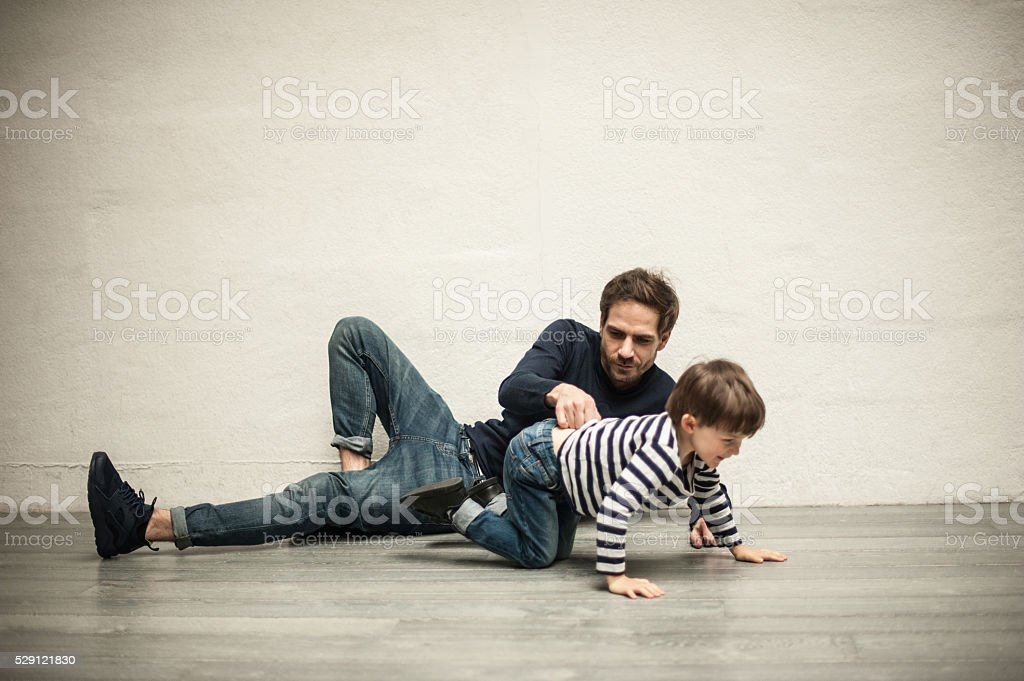 Happy young father and his son having fun stock photo