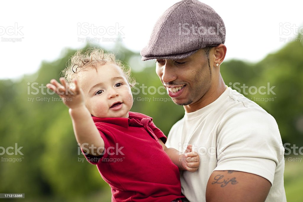 Happy, Young Father and Son Enjoying Summer Day Outdoors royalty-free stock photo