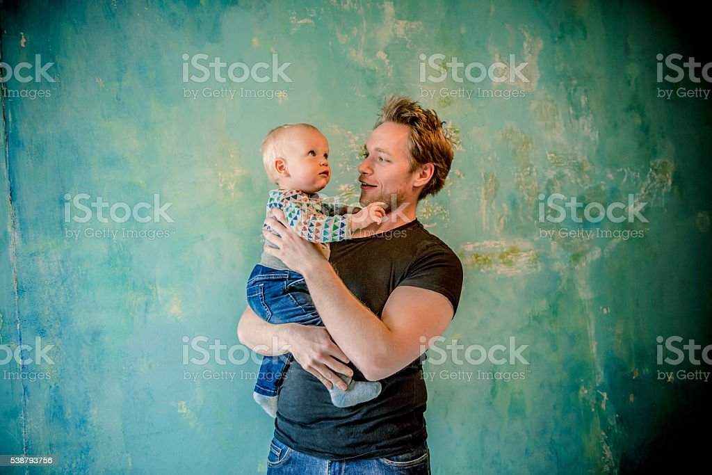 Happy Young Father Holding His Son, Paris, France stock photo