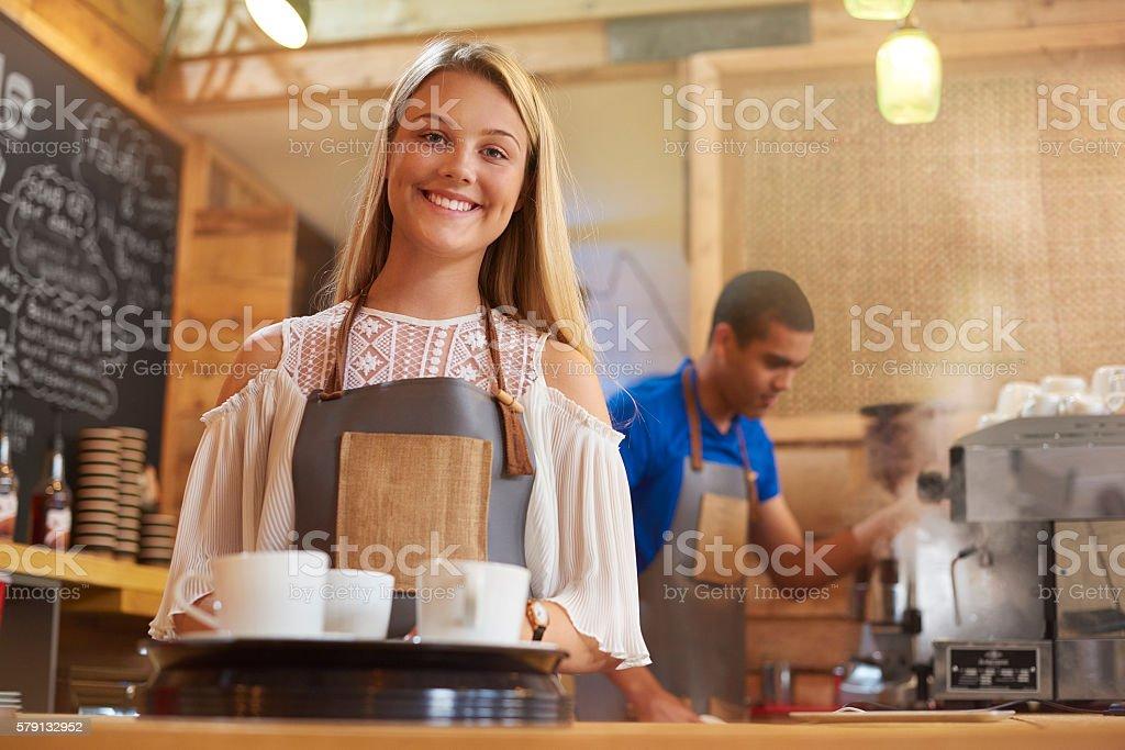 happy young female barista stock photo