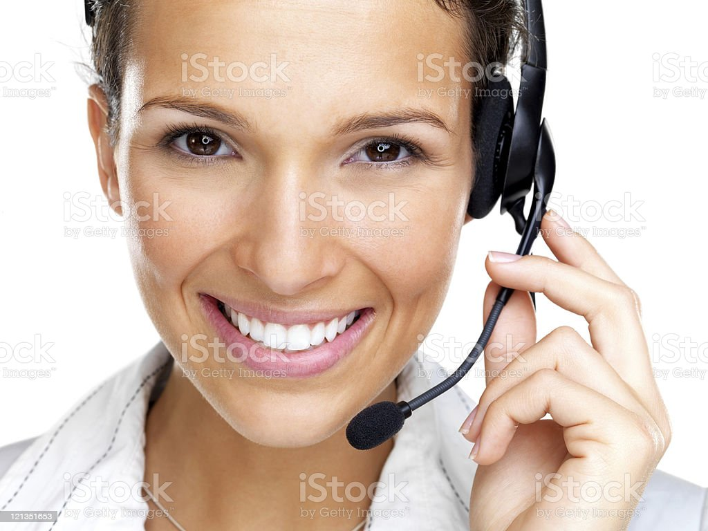 Happy, young, female call centre employee smiling with a headset royalty-free stock photo