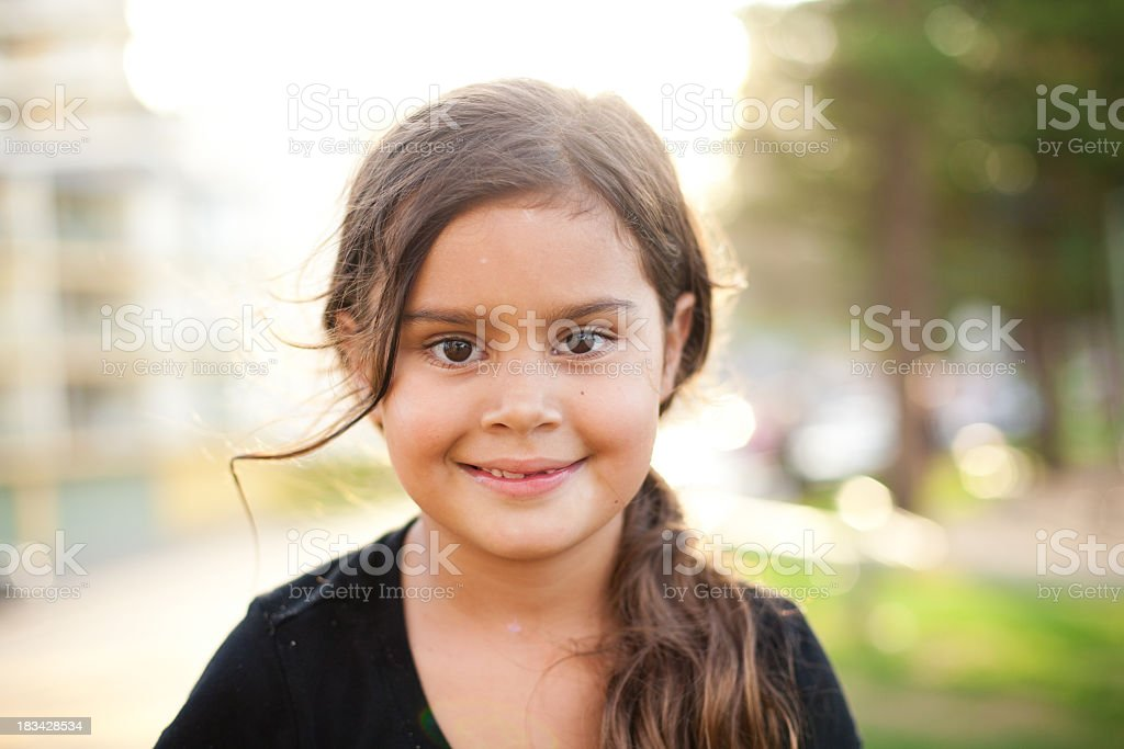 A happy young female enjoying the summer stock photo
