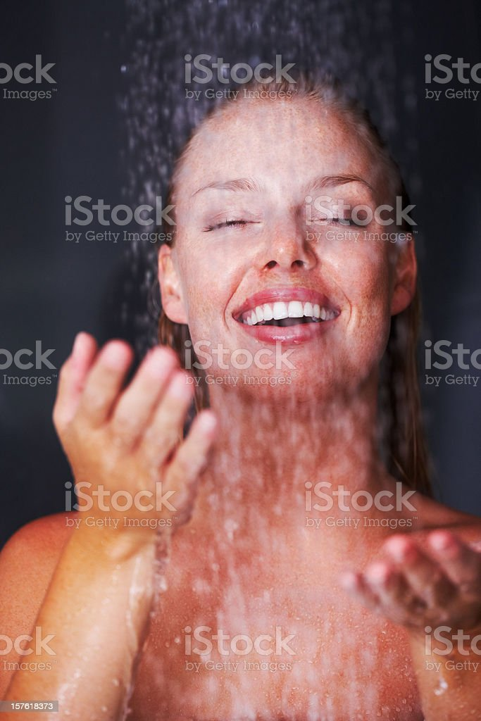 Happy young female having a bath royalty-free stock photo