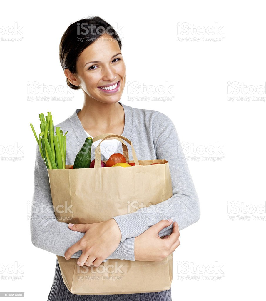 Happy young female holding a shopping bag full of groceries royalty-free stock photo
