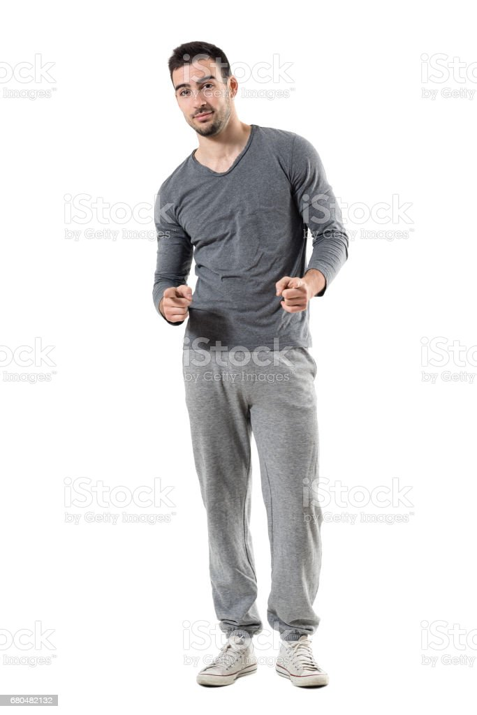 Happy young fit sporty athletic man pointing finger choosing you stock photo