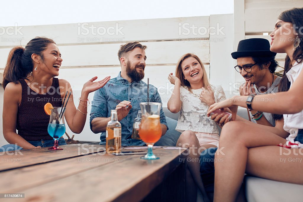 Happy young friends enjoying at a party stock photo