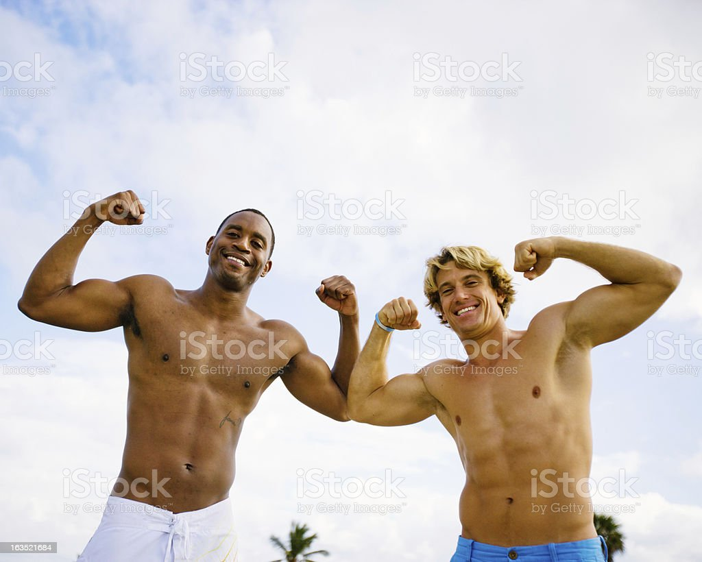 Happy Young Friends Flexing Muscles royalty-free stock photo