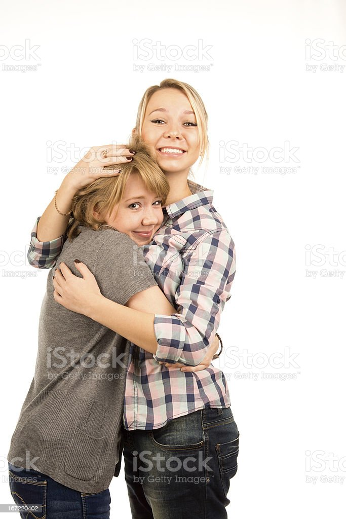 Happy young friends giving each other a hug royalty-free stock photo