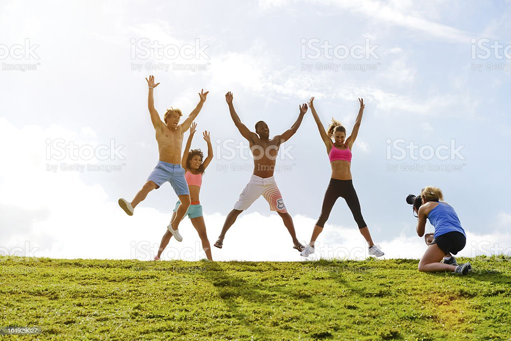 Happy Young Friends Jumping during Photo Shoot royalty-free stock photo