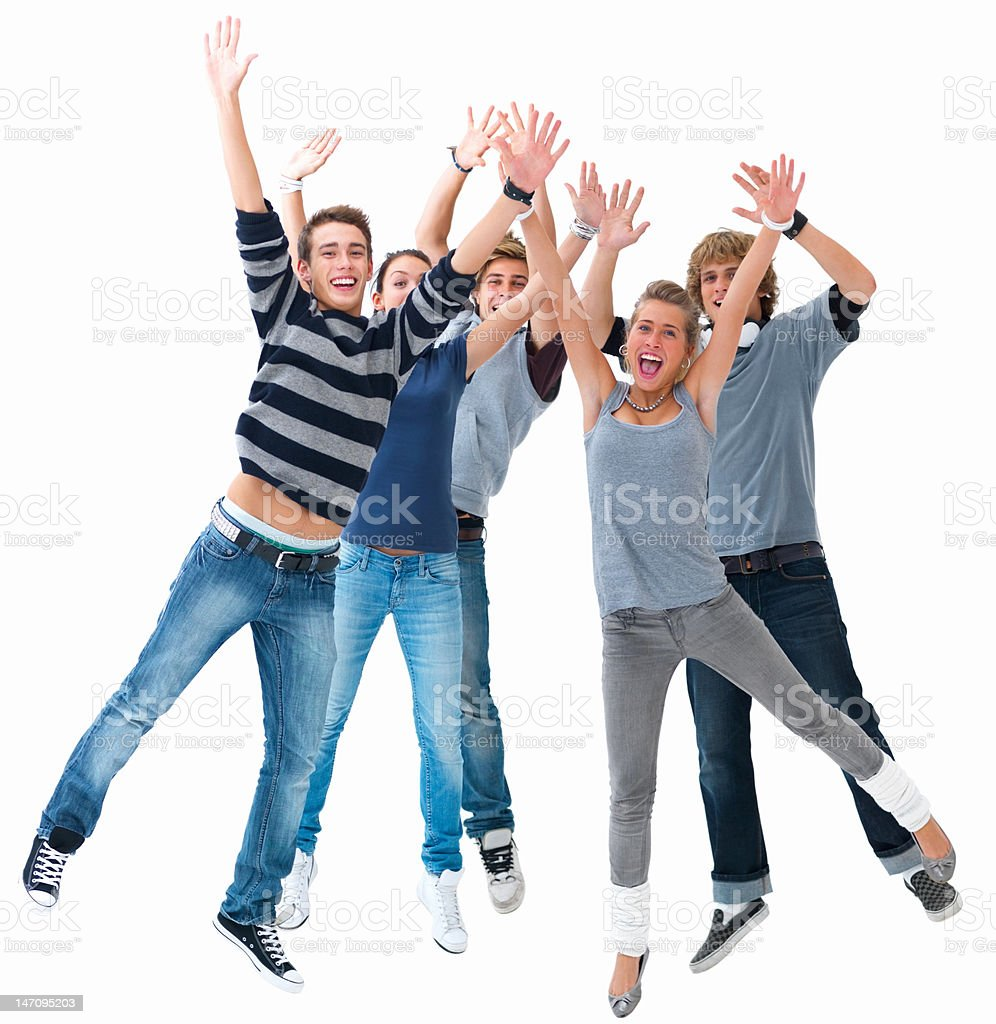 Happy young friends jumping with hands raised royalty-free stock photo