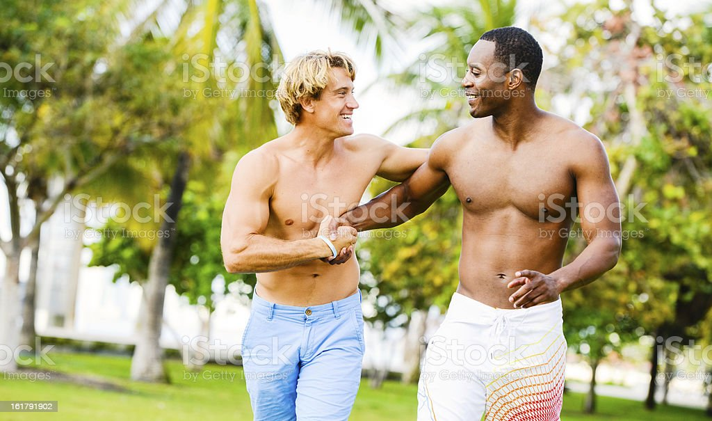 Happy Young Friends Meeting Outdoors To Exercise together royalty-free stock photo