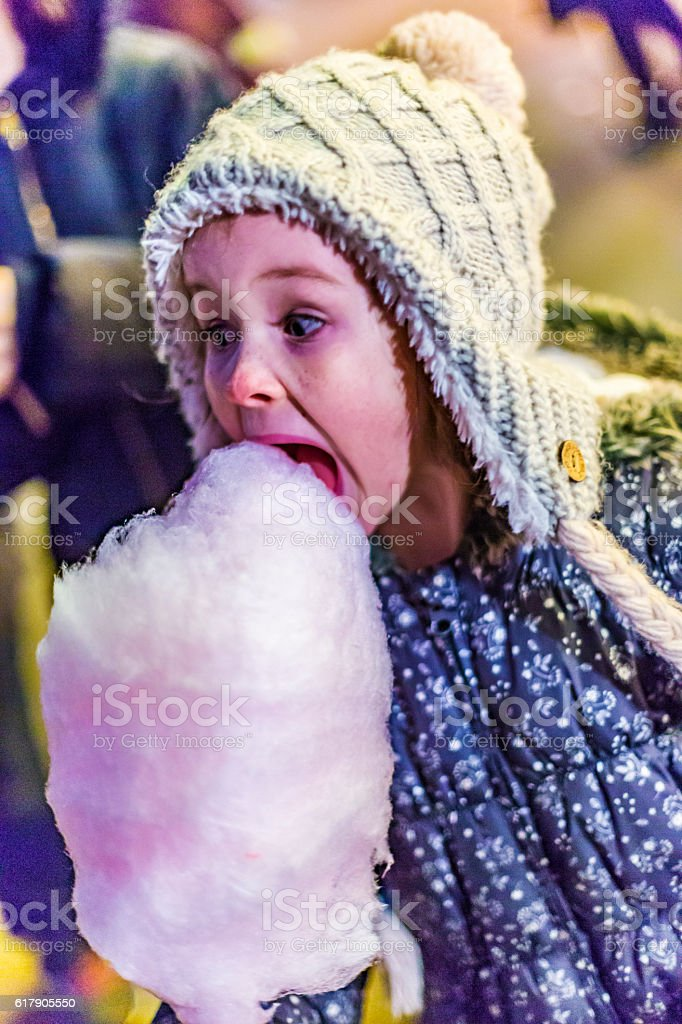 Happy Young Girl Eating Fairy Floss Cotton Candy stock photo