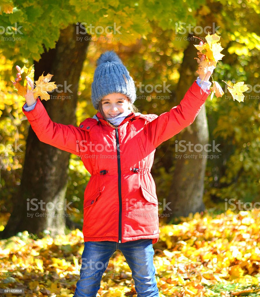 Happy Young Girl Enjoying in the Autumn stock photo