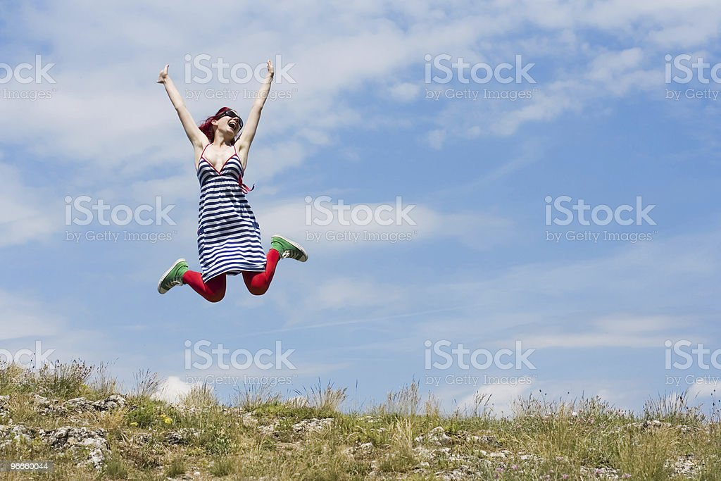 Happy young girl enjoys the sun royalty-free stock photo