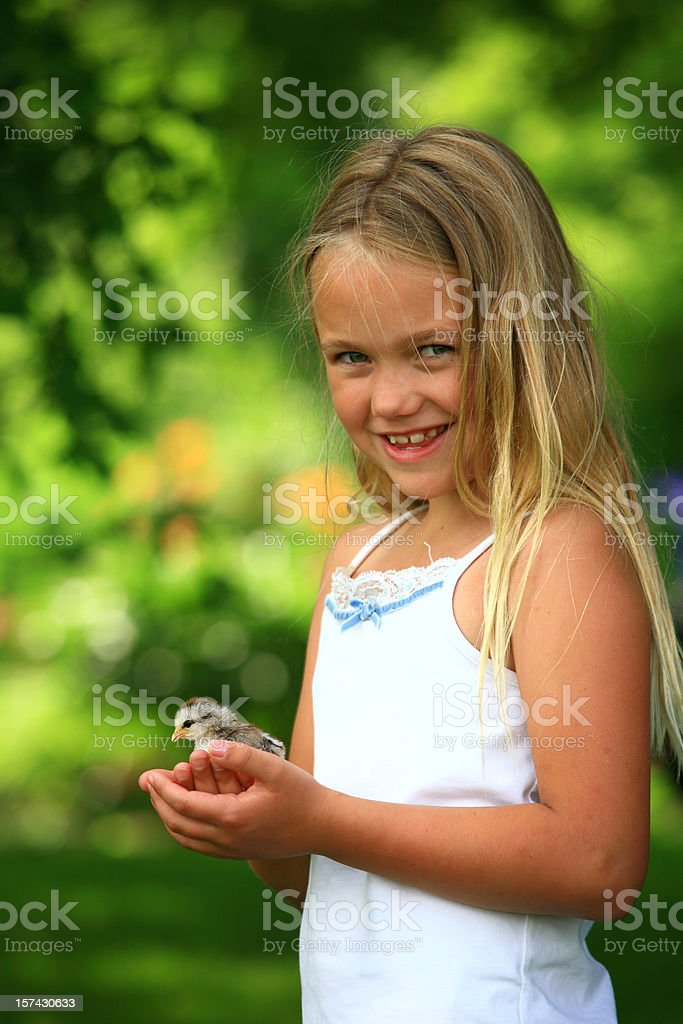 Happy Young Girl Holding a Chick royalty-free stock photo