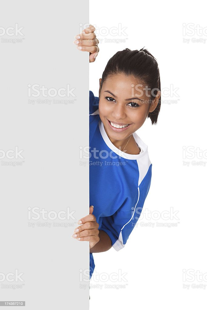 Happy Young Girl Holding Volleyball And Placard royalty-free stock photo