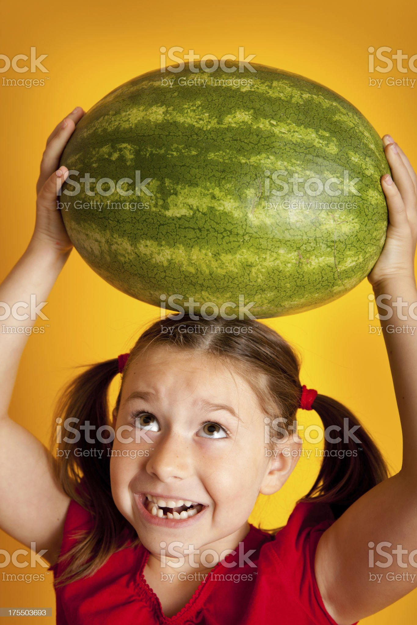 Happy Young Girl Holding Watermelon on Her Head royalty-free stock photo