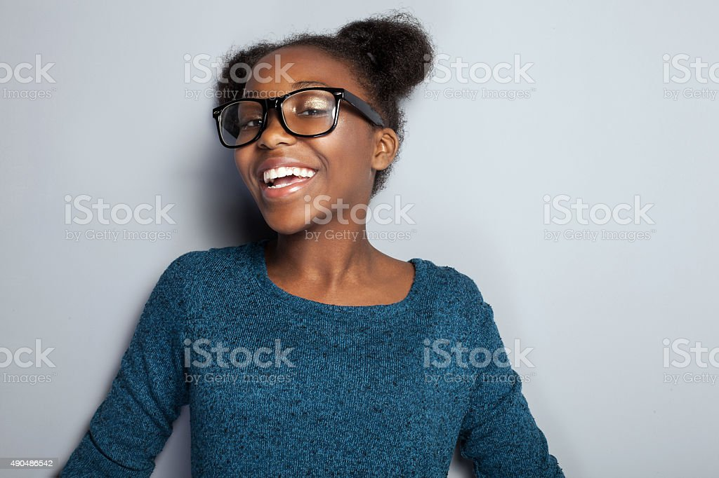 Happy young girl in eyeglasses. stock photo