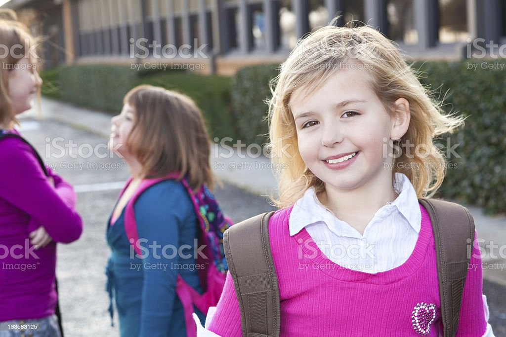 Happy Young Girl In Front of School Building royalty-free stock photo