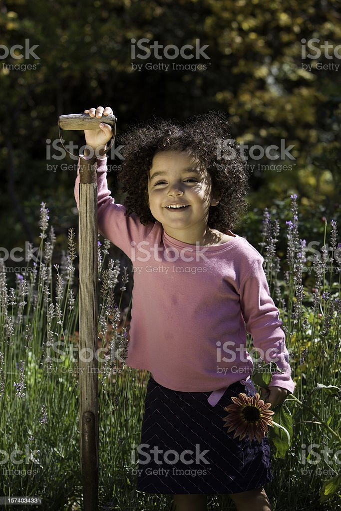 Happy Young Girl in the Garden royalty-free stock photo