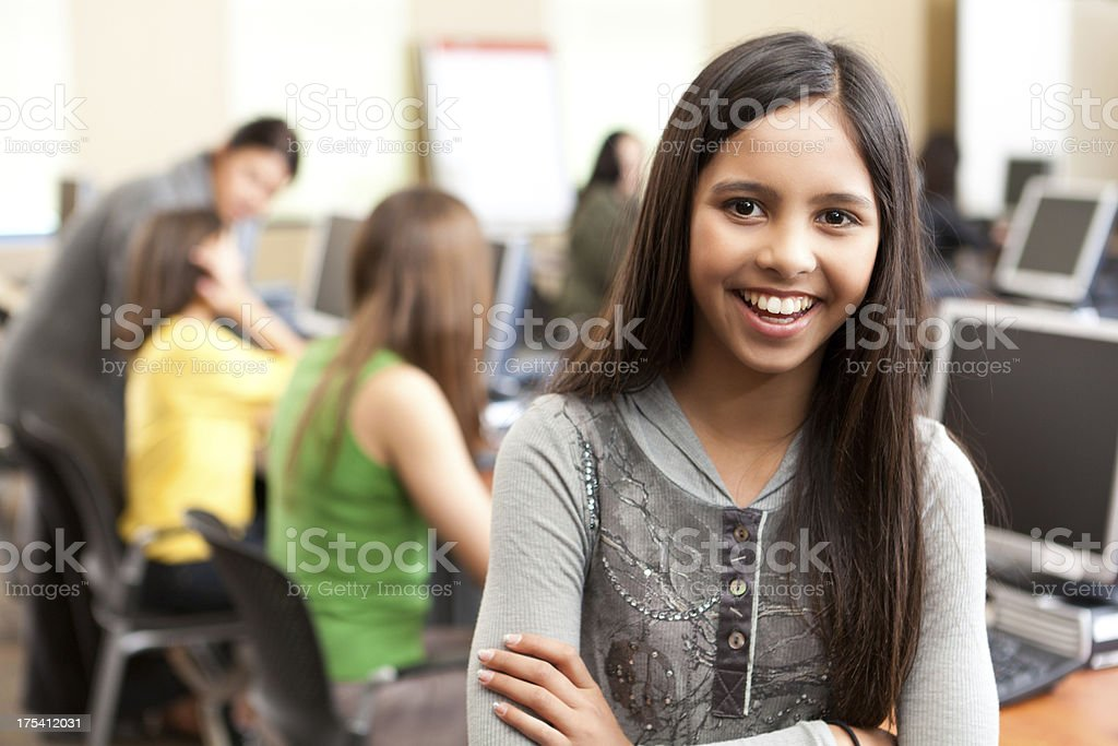 Happy young girl in the school computer lab royalty-free stock photo