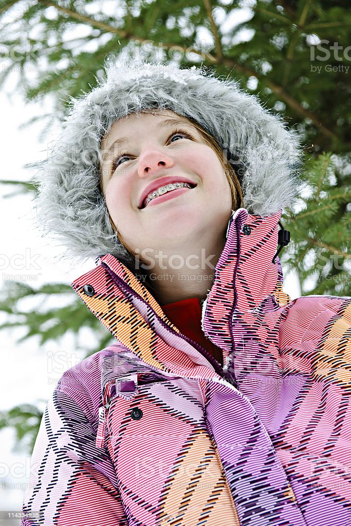 Happy young girl in winter jacket stock photo