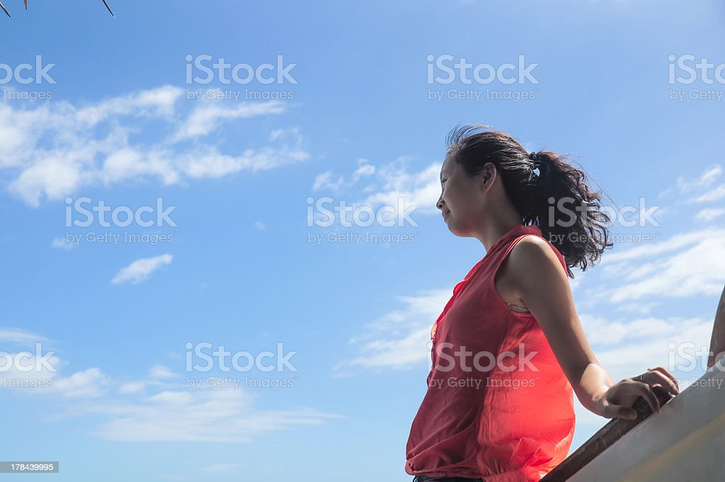 happy young girl leans on wooden boat royalty-free stock photo