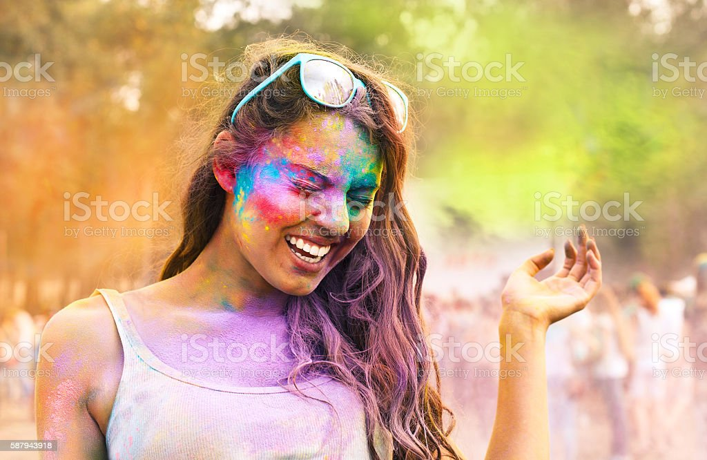 Happy young girl on holi color festival stock photo