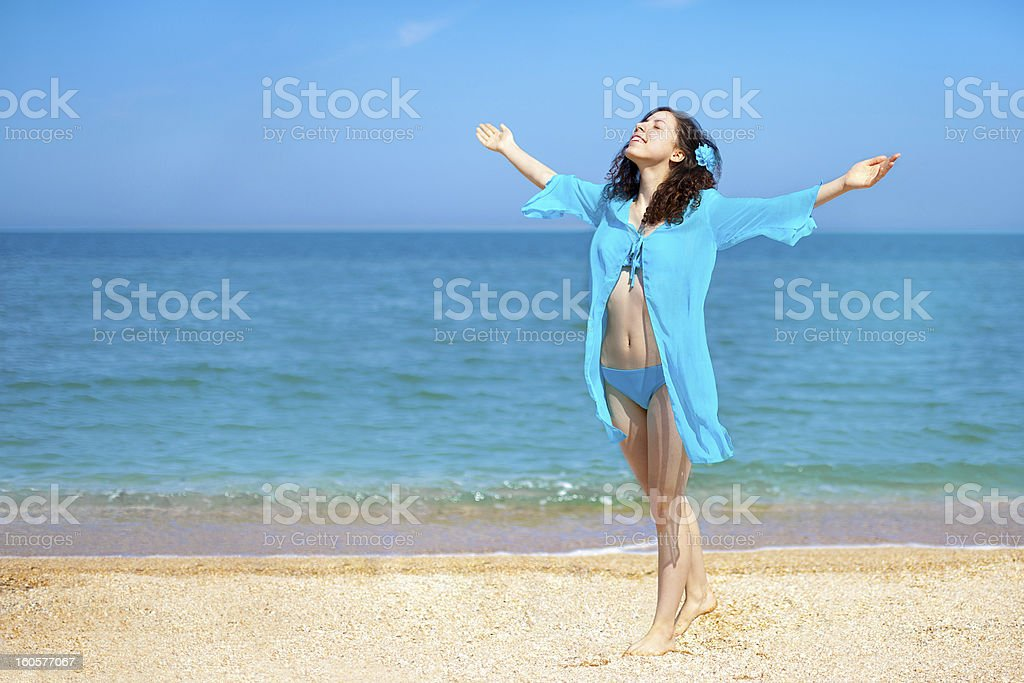 Happy young girl on the beach royalty-free stock photo