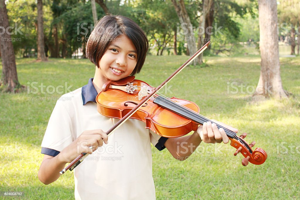 Happy young girl playing his violin stock photo