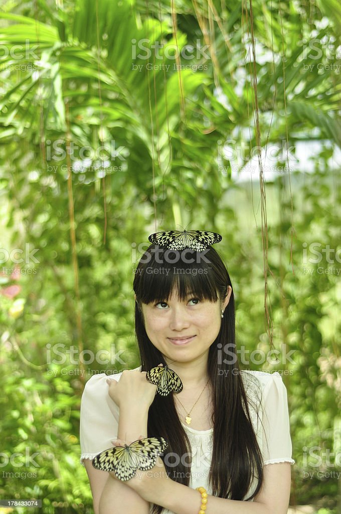 happy young girl playing with butterfly in garden royalty-free stock photo