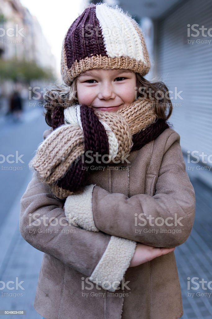 Happy young girl posing in the street. stock photo