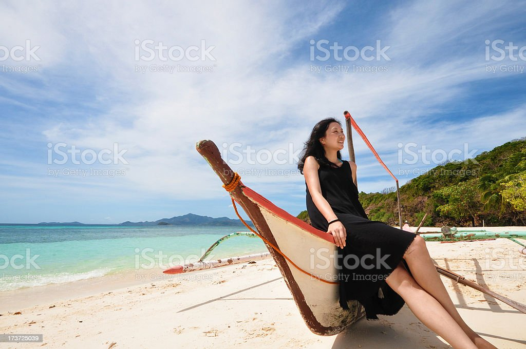 happy young girl sit on beach boat royalty-free stock photo