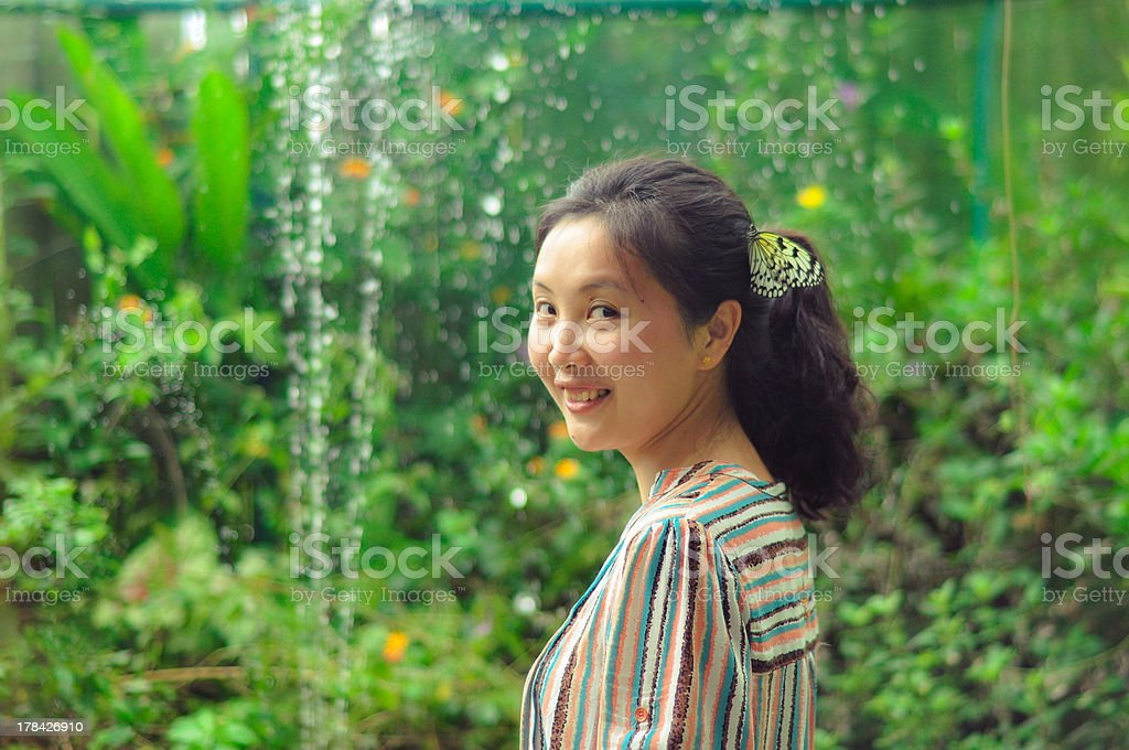 happy young girl smiling at camera in garden royalty-free stock photo