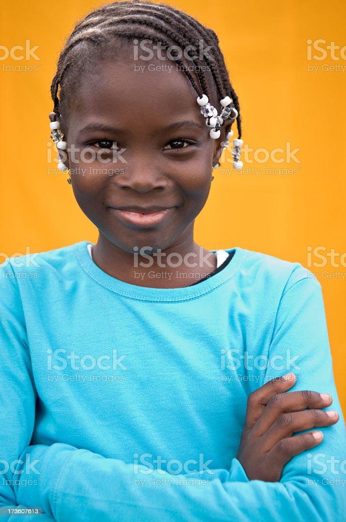 Happy Young Girl Smiling on Orange Background royalty-free stock photo