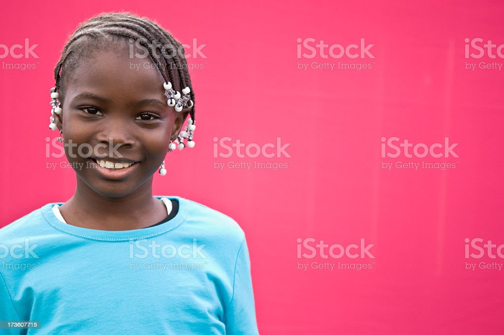 Happy Young Girl Smiling on Pink Background royalty-free stock photo