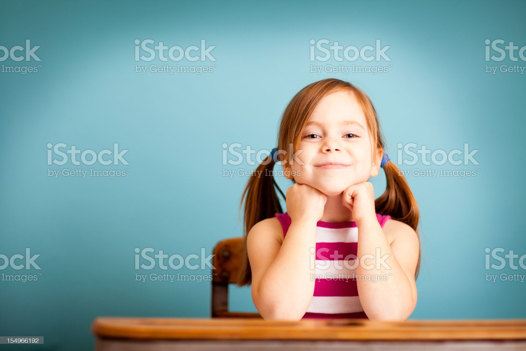 Happy Young Girl Student Sitting in School Desk royalty-free stock photo