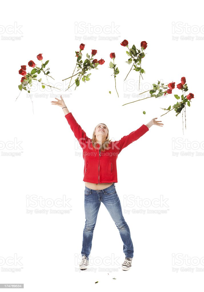 Happy Young Girl Tossing Roses into the Air with Joy stock photo