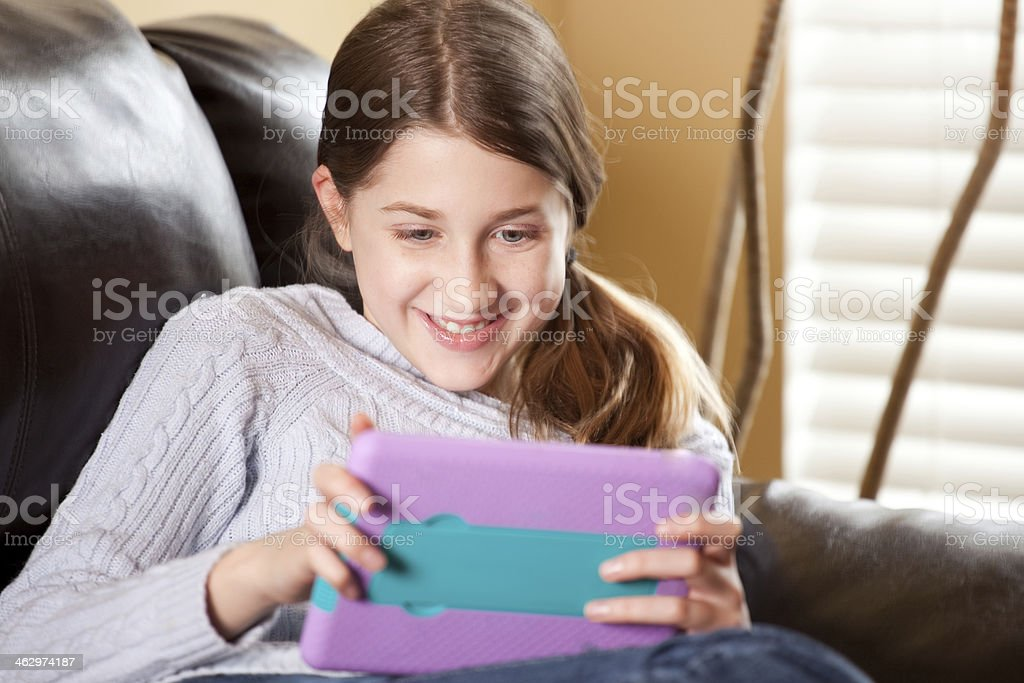 Happy Young Girl Using Tablet Computer royalty-free stock photo