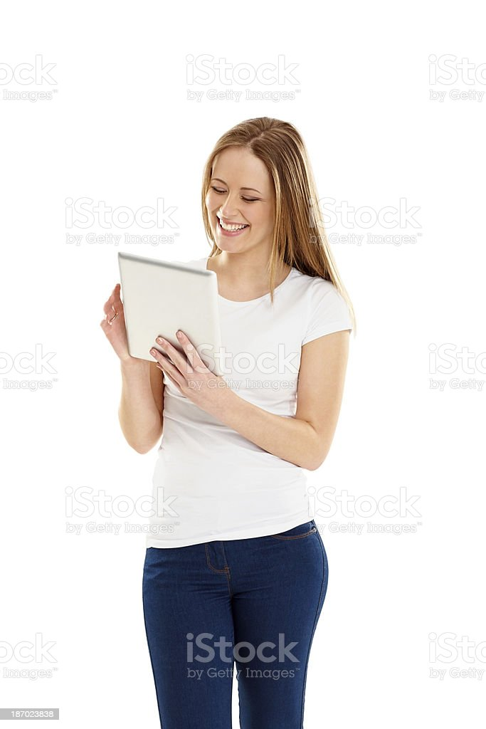 Happy young girl using tablet PC on white royalty-free stock photo